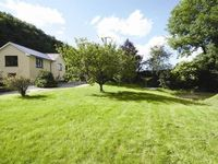 Attractive wing of original toll house Very comfortable property in delightful riverside setting