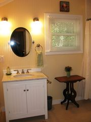Healdsburg cottage photo - Renovated hall bathroom has tub/shower combination and plenty of natural light.