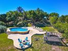 Great pool & sunning area with firepit