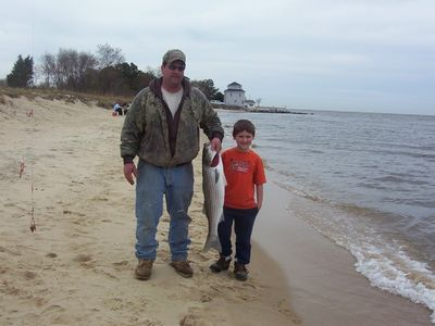 Dad and son w/Rockfish caught on Deal Island Beach