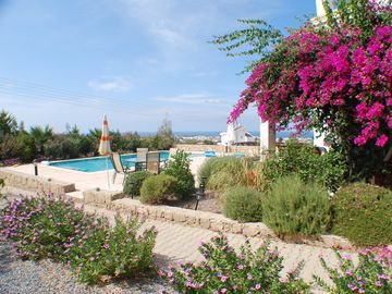 Kyrenia and sea view over mature garden and pool