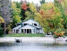 Lakeside with sand beach, there is a 50' fishing pier on left side - Branch Lake house vacation rental photo