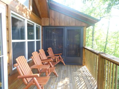 Gatlinburg rental cabin Sun Room and back deck with Adirondack chairs