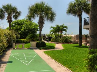 St Pete Beach condo photo - Shuffleboard on grounds with path leading to pool and beach.