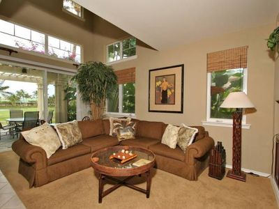 Large living room with tile and carpet, entertainment center and access to lanai