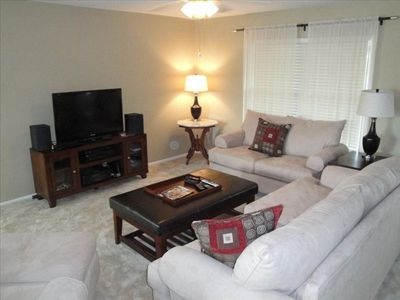 "Living room w/ 42"" flat screen, Stereo and comfy couch, loveseat and easy chair."