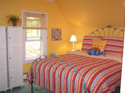 Portland house rental - Queen Bedroom with hand-painted polka-dot floors and great mattress.