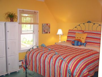 Queen Bedroom with hand-painted polka-dot floors and great mattress.