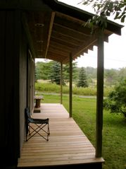 Covered deck on studio - Claryville cabin vacation rental photo