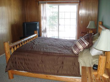 Upstairs bedroom, King size bed, balcony, and own TV