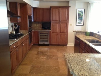Kitchen with wine cooler and tv