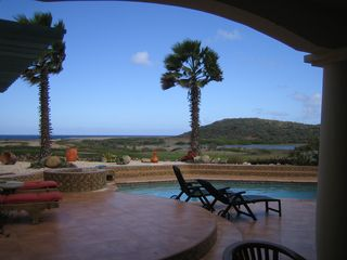 Aruba villa photo - Patio and pool area with view of the lake, 16th fairway, and the sea