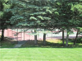 Laconia condo photo - three lighted tennis courts