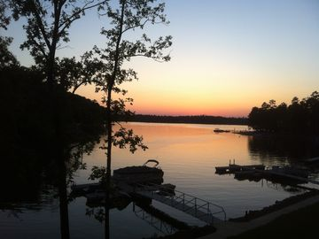 Lake Martin condo rental - View from patio with dedicated boat slips below.