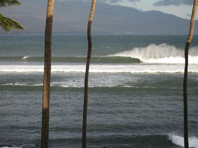 From the lanai, enjoy the local surfers ride the popular freight train.