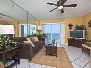 Gulf Shores condo photo - End unit with window views throughout. Living room views straight to the ocean.