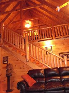 Sevierville lodge rental - Loft area w queen bedrm, queen sleeper sofa sitting area, air hockey, 32in HDTV.