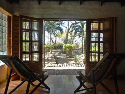 Patio with ocean view and plenty of natural light. The beach is 100 steps away!