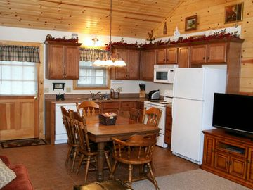Fully equipped kitchen with table service, pots, appliances and more.