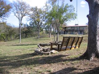 Lampasas house photo - Lazy afternoons under majestic oaks.