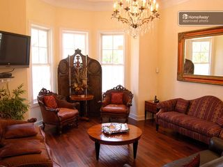 Austin house photo - Beautiful living room with a flat screen and antique walnut floors.