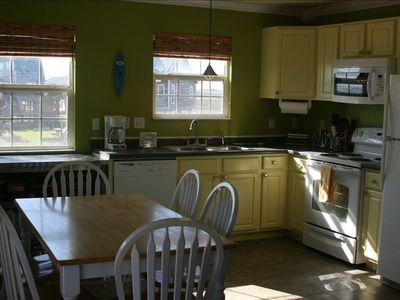 Full kitchen and dining area includes micro, range, refrigerator & dishwasher!