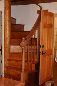 historic circular stairs rising up to the bedroom loft, full bath, and deck