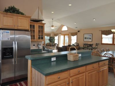 Kitchen Island/Breakfast Bar area adjoins dining area and Great Room.