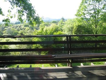 Placerville house rental - Springtime at the Deck House -- view from deck running length of living room/den
