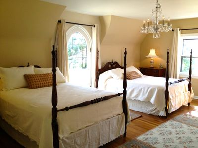 Extra large upstairs bedroom -2 queen beds. Leaded glass door to faux balcony