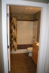 Shuswap Lake townhome photo - main floor bathroom with full bath tub and shower.