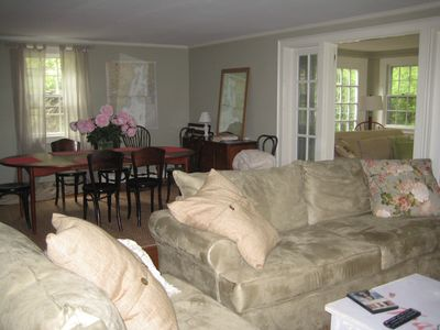 Soft muted decor Living room, dining room seats 10-12 Large sunporch on side.