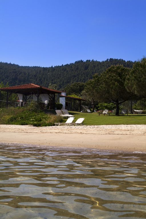 Villa right by the sea, where the wave breaks of pine wooded Vourvourou