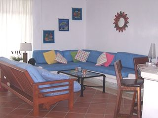 Akumal condo photo - Living Area couches,futon, sateliteTV, DVD