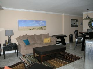 Galveston condo photo - Living room with tile floors. Bright and beach decor!