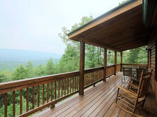 Ellijay cabin photo - Rockers and outdoor seating on the deck overlooking the mountains