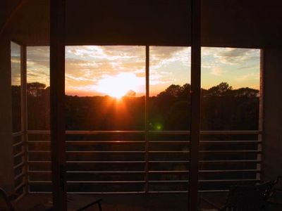 View of the sunset from the lanai. Beautiful view of forest & ribbon of the
