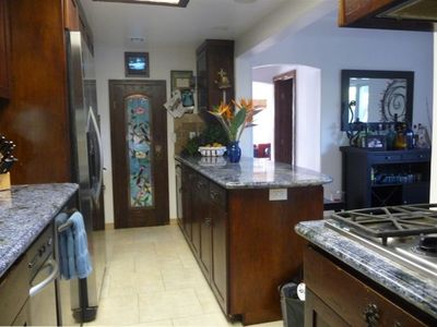 Beautifully upgraded kitchen with very rare blue granite counter tops