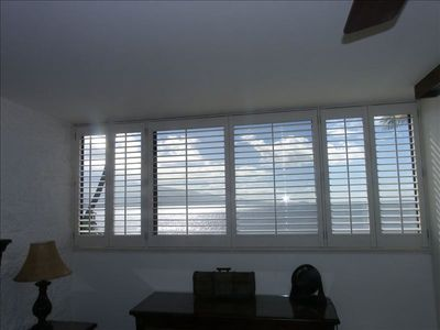 Master bedroom window with California shutters