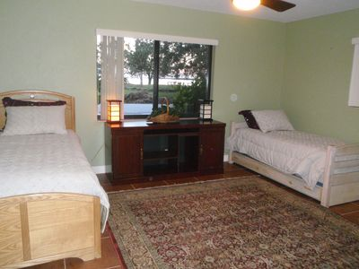 Bedroom with two twin beds and view of the water