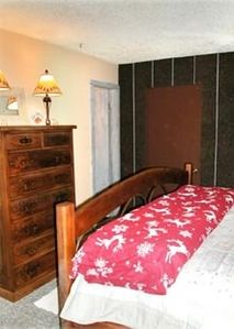 Master Bedroom with Dresser and Door to Bath