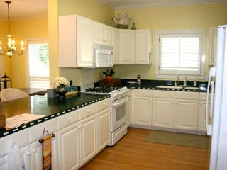 Crystal Beach house photo - Huge kitchen with lots of cabinets. Well stocked w/utensils and new appliances.