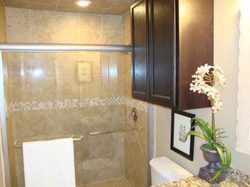 Remodeled bathrooms have custom tiling.