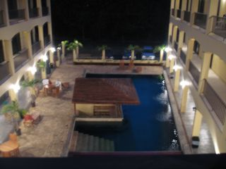 Playa del Coco condo photo - A safe and well lit pool at night.