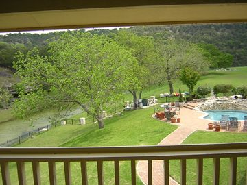 View from upper porch overlooking pool and creek
