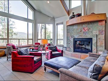 Living Room with Vaulted Ceilings & Fireplace