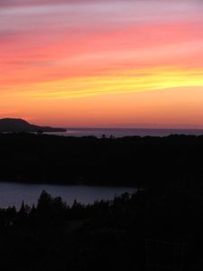 Cedar house rental - Amazing sunset views of Little Traverse Lake, Lake Michigan, & the Manitou Is