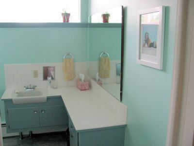 The full bath--deep tub, natural light, fresh paint and original 1957 tile.