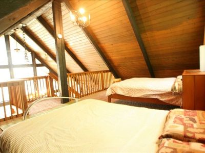 In addition to the bedroom, there is a large sleeping loft with two beds/view!