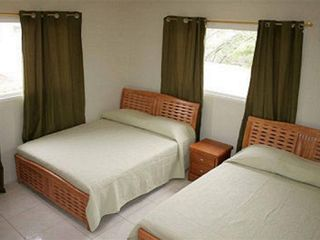 Aruba villa photo - comfortable bedroom with two beds TV Air co. & ceiling fan so nice!